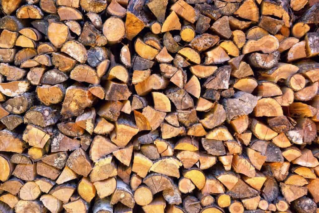 An image of a freshly chopped and stacked rick of wood