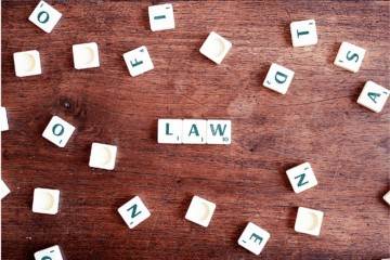Game of scrabble with tiles spelling out law