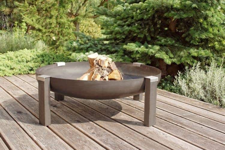 An image of a fire pit bowl on a wood deck without a deckprotect fire pit pad