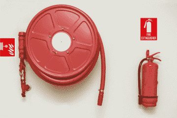 Image of a red fire hose for a blog post about fire pit safety