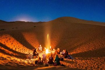 Image of people around a fire pit for a blog post about how to put out a fire pit