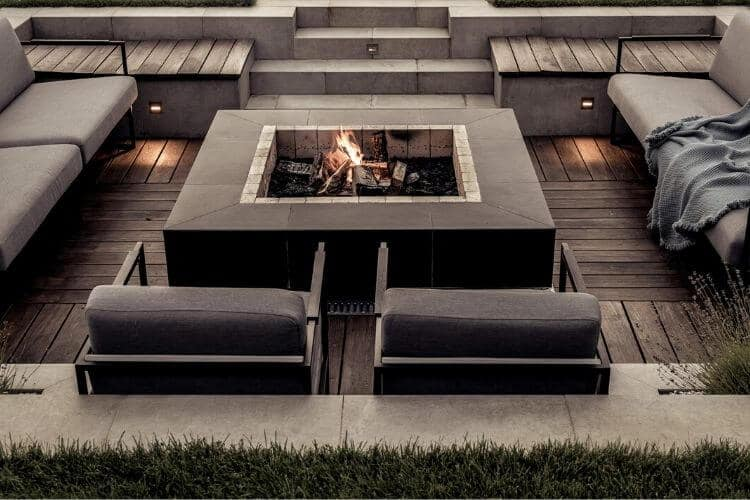 Image of a contemporary square wood burning fire pit and seating on the About Backyard Toasty page