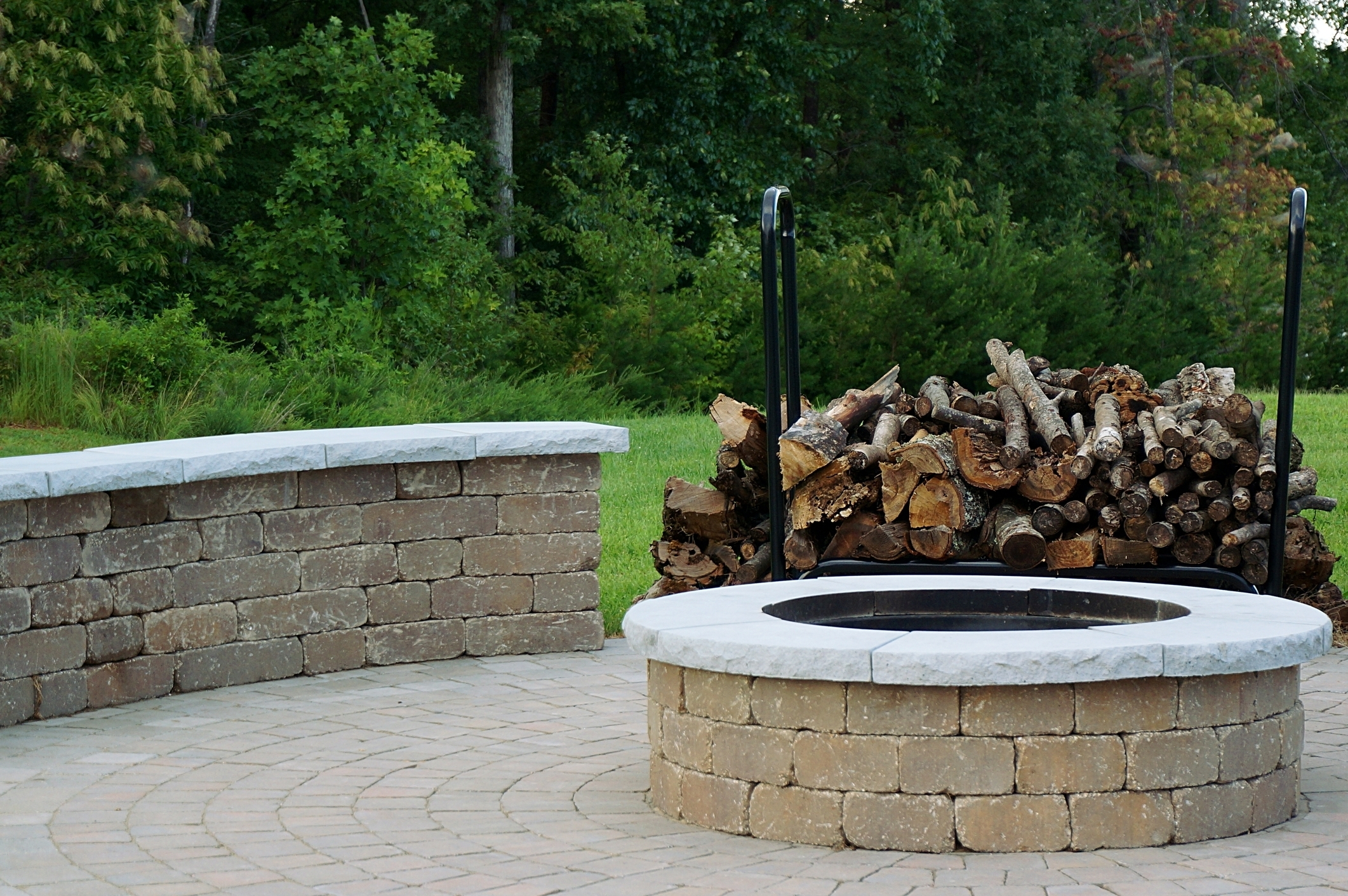Image of a stone fire pit surround with a fire pit ring insert