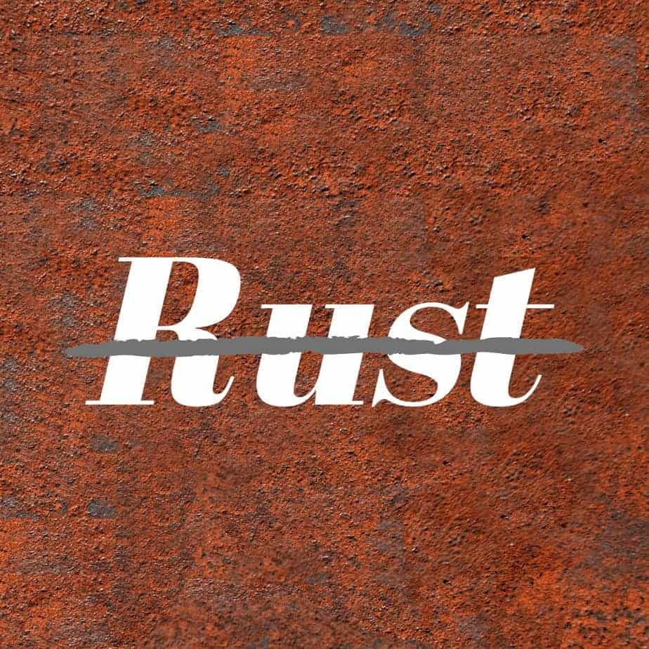 Image of fire pit rust with the word rust crossed out