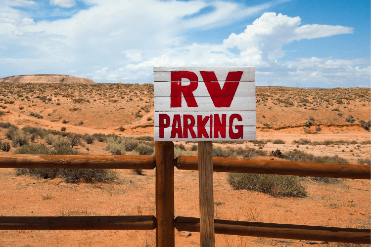 Image of RV parking sign in the desert