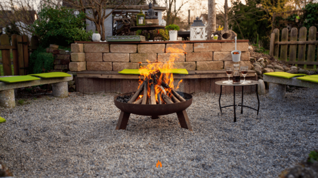 Image of a wood-burning fire pit burning in the early evening